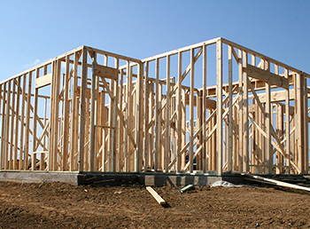 Image of a partially-built house linking to the Build On Your Lot site